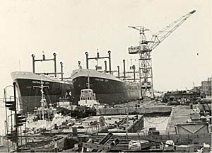 The two ships alongside in shipyard