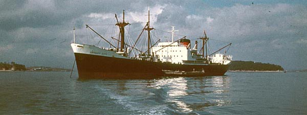 Cardiff City loading at anchor.
