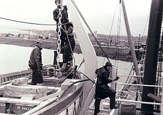 Four cadets working on lifeboat