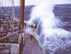 Waves breaking over the bow