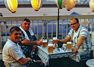 Three officers having a beer when ashore