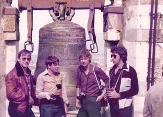Four cadets in front of bell on Tower of Pisa
