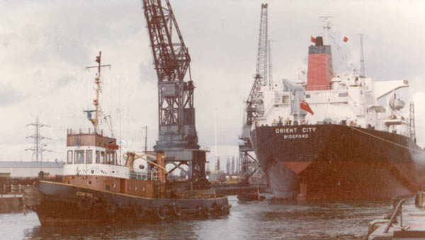 Towed astern with a tug
